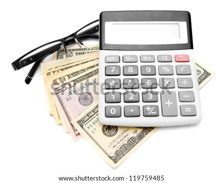 Calculator and glasses on a pack of dollars. - stock photo