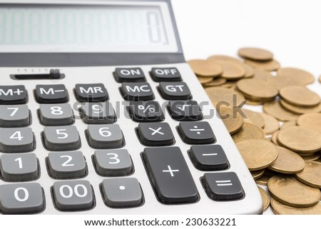 Calculator and gold coins. - stock photo