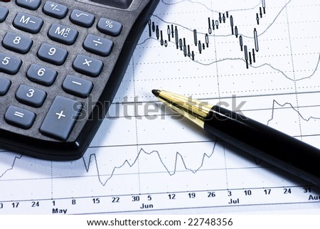 calculator and golden pen on business background