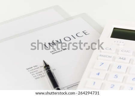 calculator and invoice. - stock photo