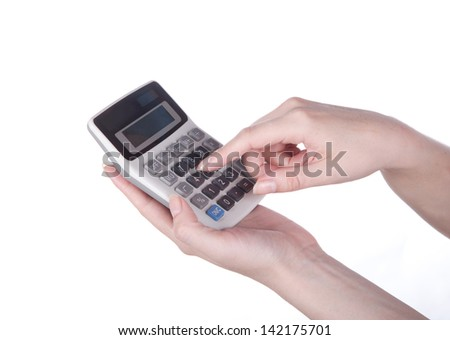 calculator and money in hand on white