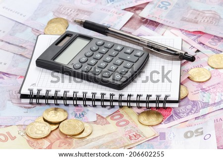 Calculator and notebook - stock photo