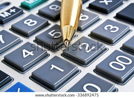 Calculator and pen, close up - stock photo