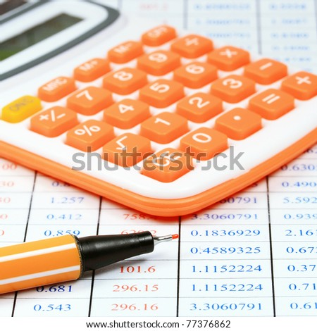 calculator and pen on a table of business background - stock photo