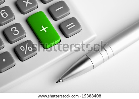 calculator and pen. plus button colored green - stock photo