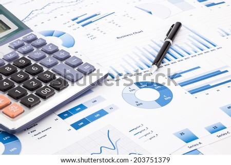calculator and pen with blue business charts, graphs, information and reports background for financial and business concepts - stock photo