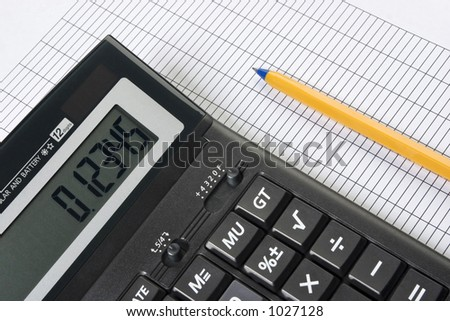 Calculator and pencil. Nice closeup, no dust or scratches. - stock photo