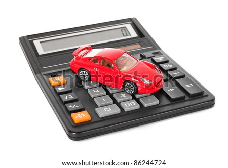 Calculator and red toy car isolated on white background - stock photo