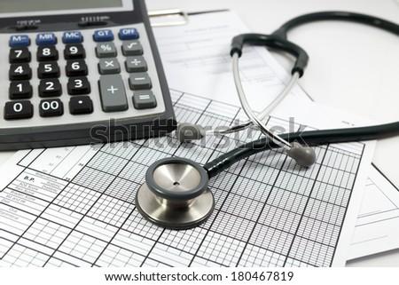 calculator and stethoscope  - stock photo