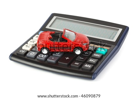 Calculator and toy car isolated on white background - stock photo