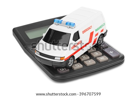 Calculator and toy medical car isolated on white background - stock photo