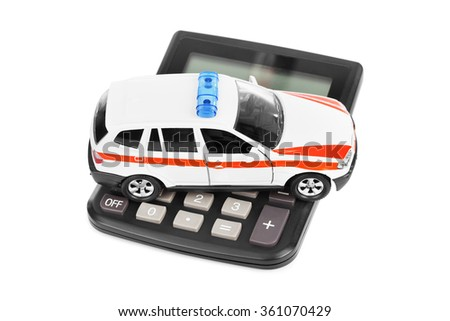Calculator and toy police car isolated on white background