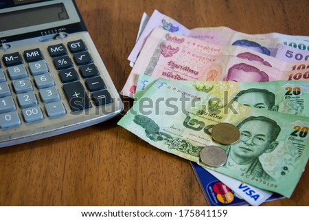 Calculator, ATM cards and thai banknotes.  - stock photo
