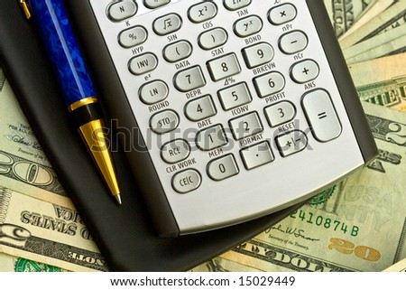 calculator, banknotes and pen on top