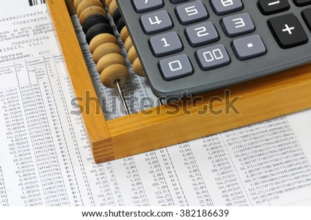 Calculator, bills, and the numbers on the list. Business still life