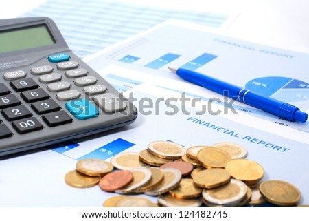 Calculator, coins and annual report. - stock photo