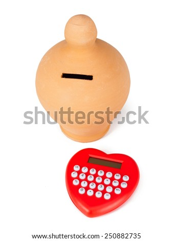 Calculator heart shaped and money box. Concept of calculation and savings. - stock photo