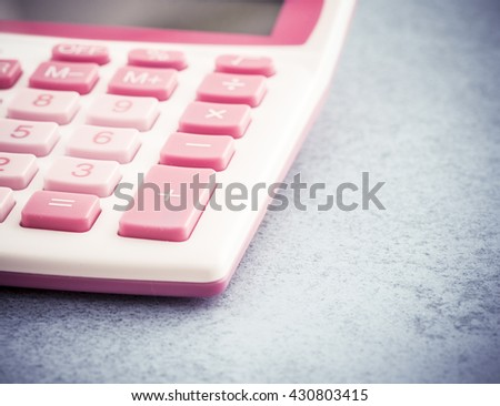 Calculator in office on empty stone table. Concept of financial business, education or household economy. - stock photo
