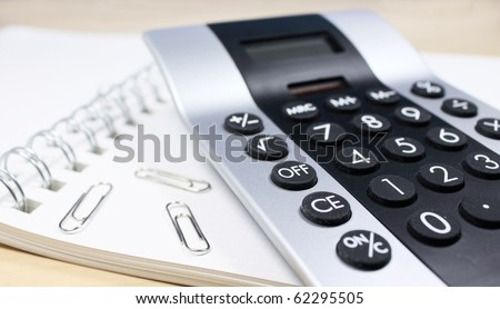 calculator in the office - stock photo