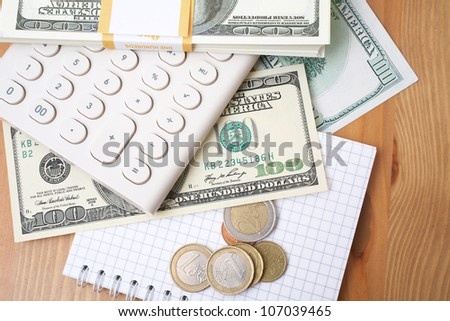 Calculator, money and notebook - stock photo