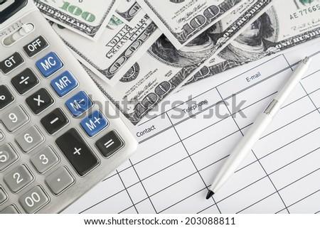 Calculator, money and pen  - stock photo
