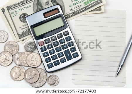 Calculator, money, pen and empty lined paper to white a shopping list. - stock photo