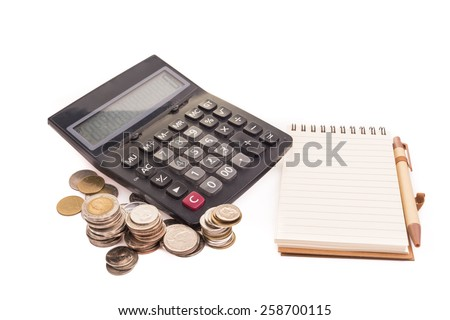 Calculator , Note and Coins in office - stock photo