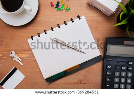 calculator note credit card key on the wood table
