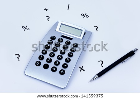 calculator on a white background with different symbols all around and a pencil on the side - stock photo