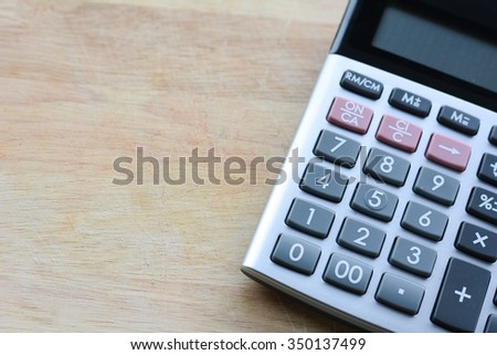 Great Calculator On A Wooden Floor