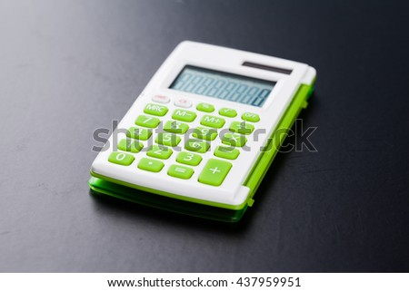 Calculator on black background - stock photo