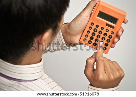 Calculator on businessman's hand, business concept of finance . - stock photo