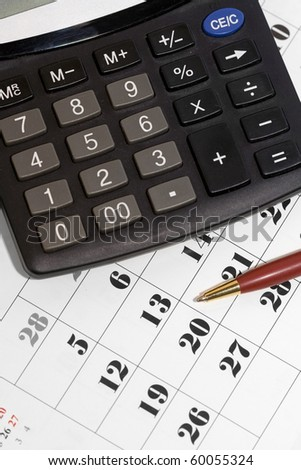 Calculator on calendar - days left calculation concept (credit, vacation, holiday, etc.) - stock photo
