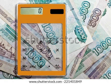 Calculator on Russian banknotes - stock photo