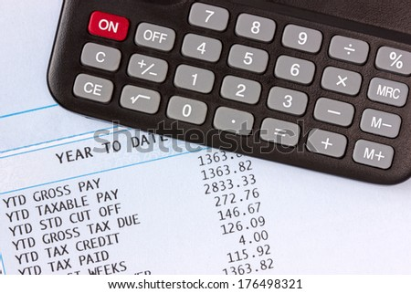 Calculator  on the statement of payroll details - stock photo