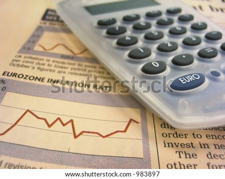 Calculator over eurozone inflation rate chart - stock photo