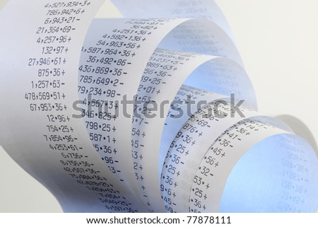 Calculator paper tape rolled up - stock photo