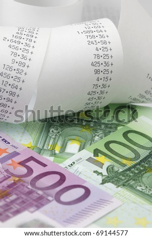 Calculator paper tape with euro bills - stock photo