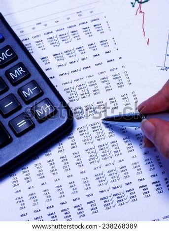 Calculator, pen and diagram - stock photo
