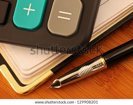 Calculator, Pen and Diary
