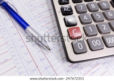 Calculator, pen and ledger paper - stock photo