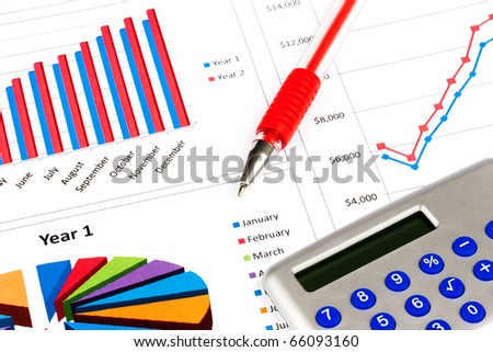 Calculator pen and stock charts money investment concept - stock photo