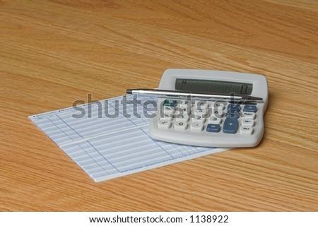 calculator pen check register - stock photo