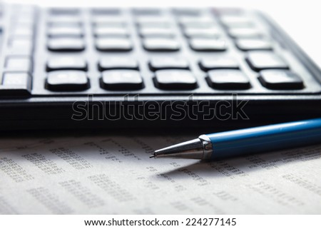 Calculator, pen, document lying on the desk - stock photo
