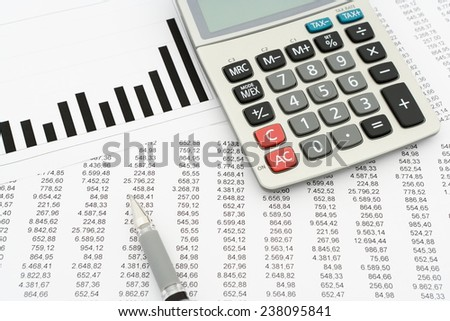 calculator, pen, documents with numbers and diagram