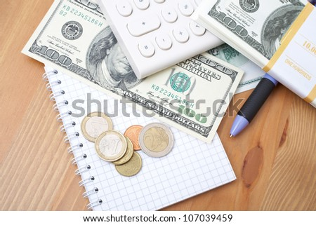 calculator, pen, notebook and money - stock photo