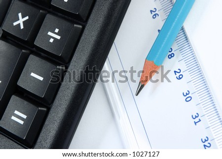 Calculator, pencil and a ruler. Nice closeup, no dust or scratches.