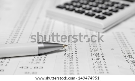 Calculator, receipts, pen - stock photo