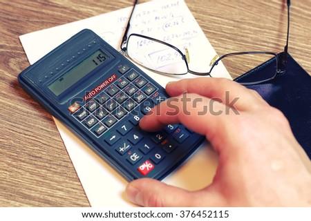 calculator table glasses  - stock photo