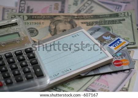 calculator, US money, credit cards and checkbook - stock photo